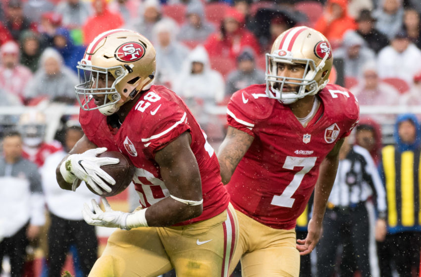 November 20, 2016; Santa Clara, CA, USA; San Francisco 49ers running back Carlos Hyde (28) receives the hand off from quarterback Colin Kaepernick (7) during the first quarter against the New England Patriots at Levi's Stadium. The Patriots defeated the 49ers 30-17. Mandatory Credit: Kyle Terada-USA TODAY Sports