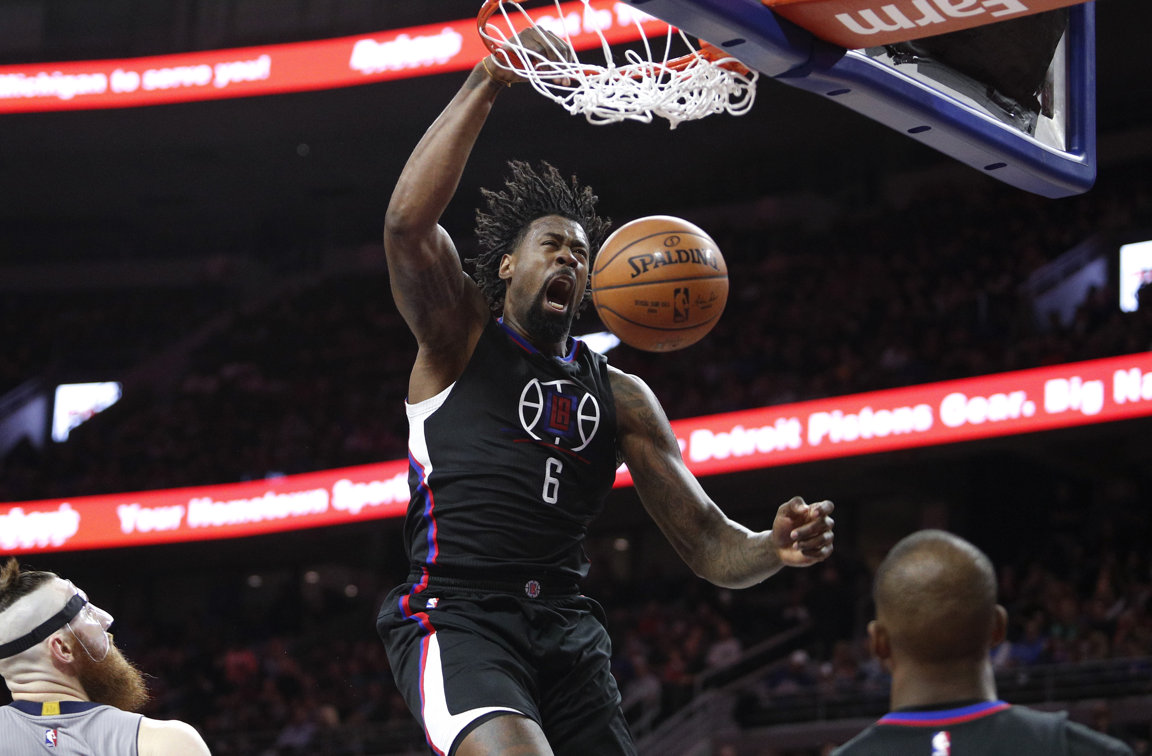 Nov 25, 2016; Auburn Hills, MI, USA; LA Clippers center DeAndre Jordan (6) makes a dunk against Detroit Pistons center Aron Baynes (12) during the second quarter at The Palace of Auburn Hills. Mandatory Credit: Raj Mehta-USA TODAY Sports