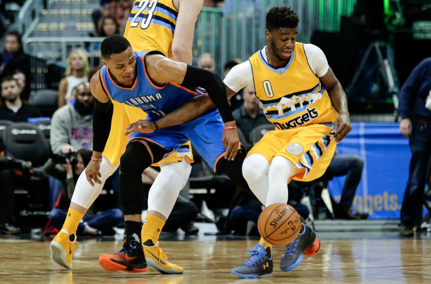 Nov 25, 2016; Denver, CO, USA; Oklahoma City Thunder guard Russell Westbrook (0) and Denver Nuggets guard Emmanuel Mudiay (0) battle for the ball in the third quarter at the Pepsi Center. The Thunder won 132-129. Mandatory Credit: Isaiah J. Downing-USA TODAY Sports