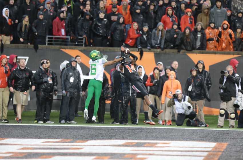 Nov 26, 2016; Corvallis, OR, USA; Oregon Ducks wide receiver Charles Nelson (6) and Oregon State Beavers cornerback Treston Decoud (14) fight for the ball in the second half at Reser Stadium. Mandatory Credit: Scott Olmos-USA TODAY Sports