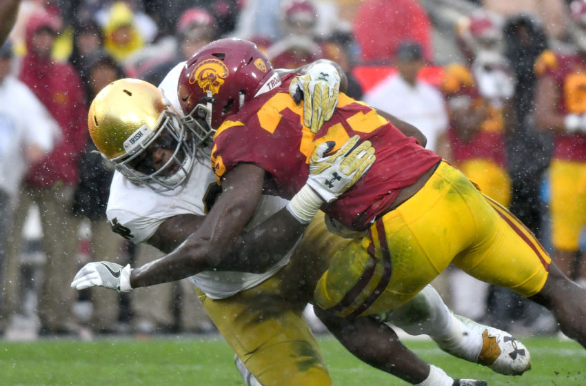Nov 26, 2016; Los Angeles, CA, USA; Notre Dame Fighting Irish defensive lineman Jarron Jones (94) tackles USC Trojans running back Ronald Jones II (25) in the second quarter at the Los Angeles Memorial Coliseum. USC won 45-27. Mandatory Credit: Matt Cashore-USA TODAY Sports