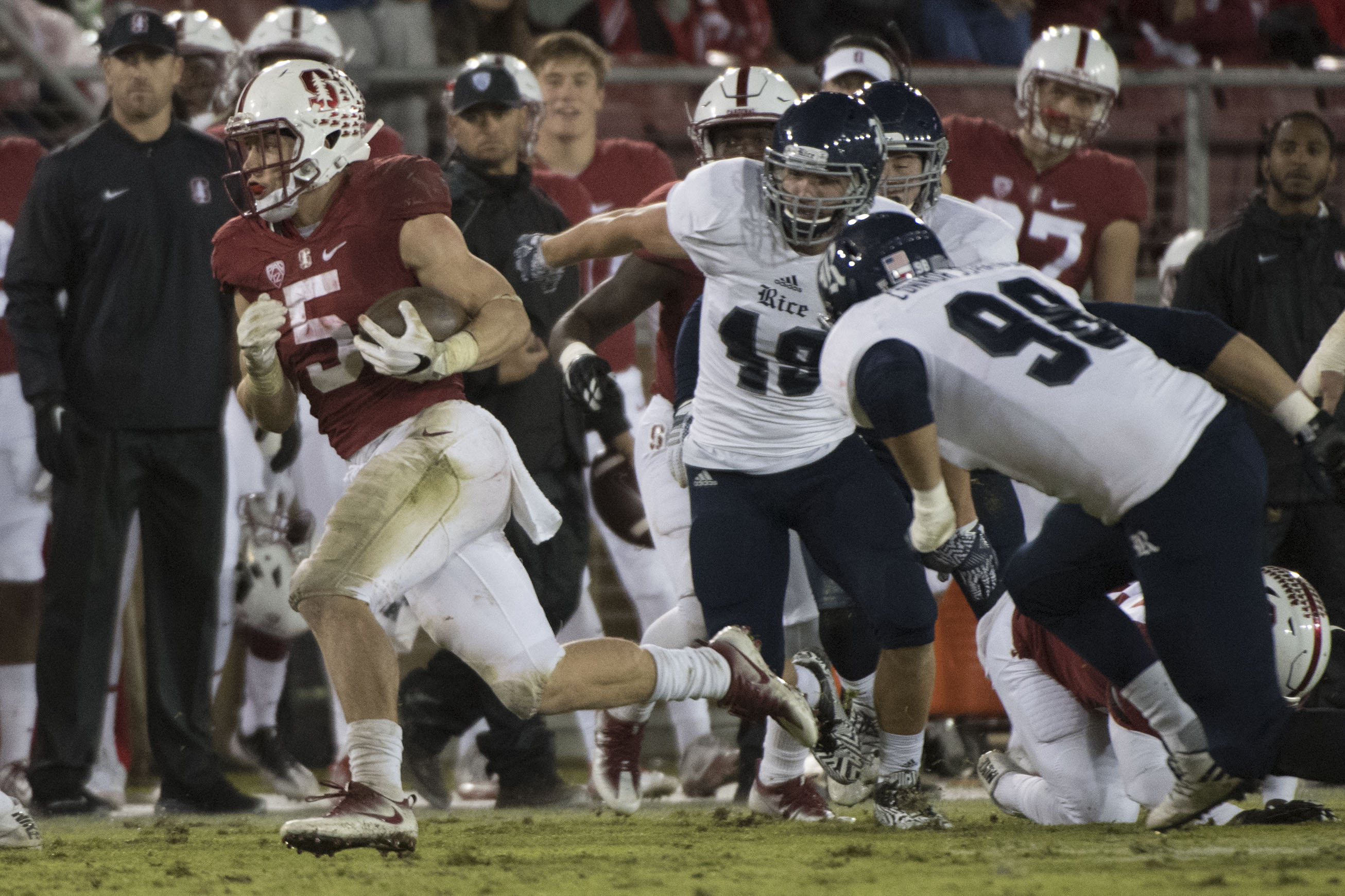 November 26, 2016; Stanford, CA, USA; Stanford Cardinal running back Christian McCaffrey (5) runs past Rice Owls linebacker DJ Green (49) during the first quarter at Stanford Stadium. Mandatory Credit: Kyle Terada-USA TODAY Sports