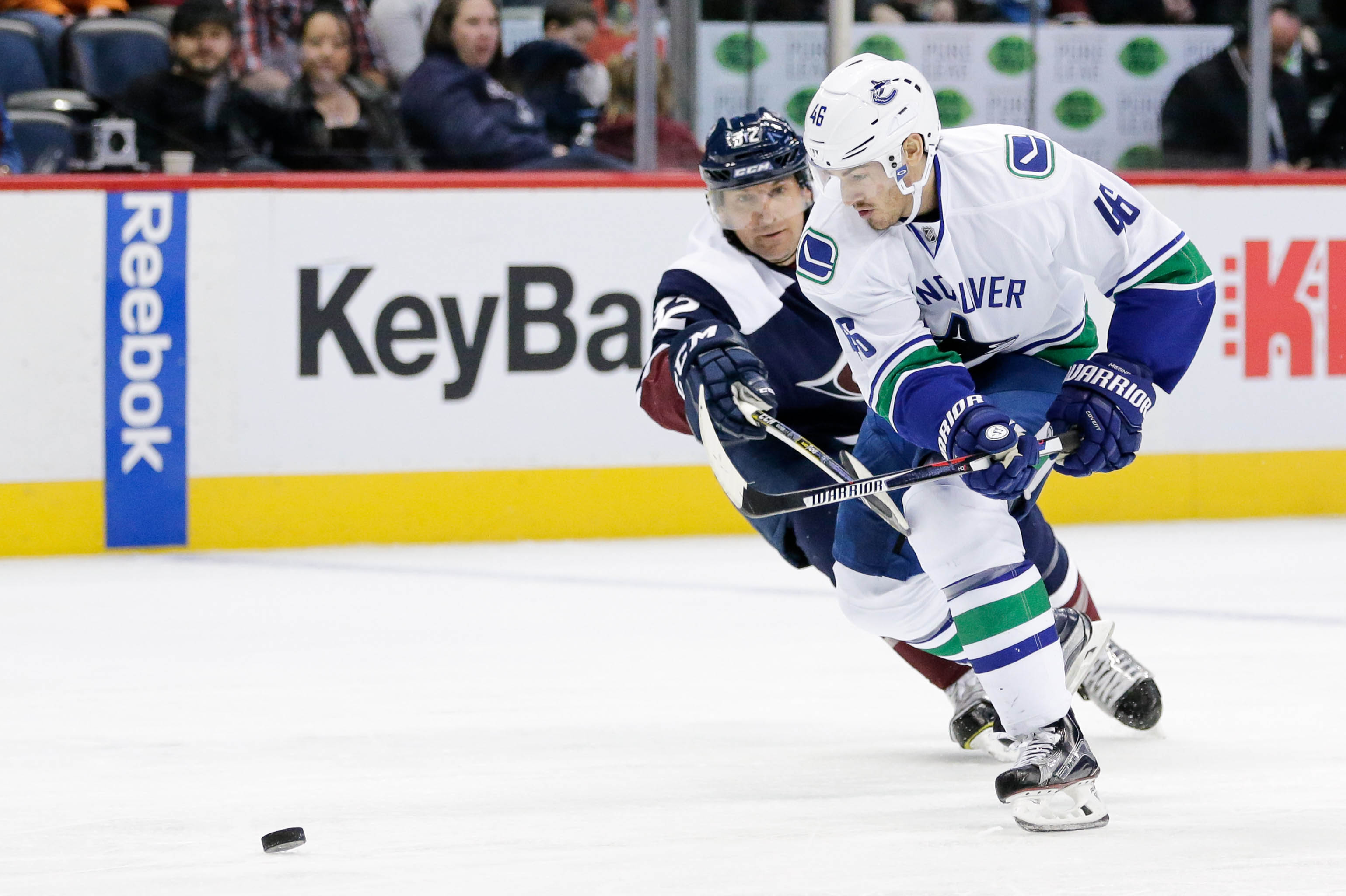 9708439-nhl-vancouver-canucks-at-colorado-avalanche