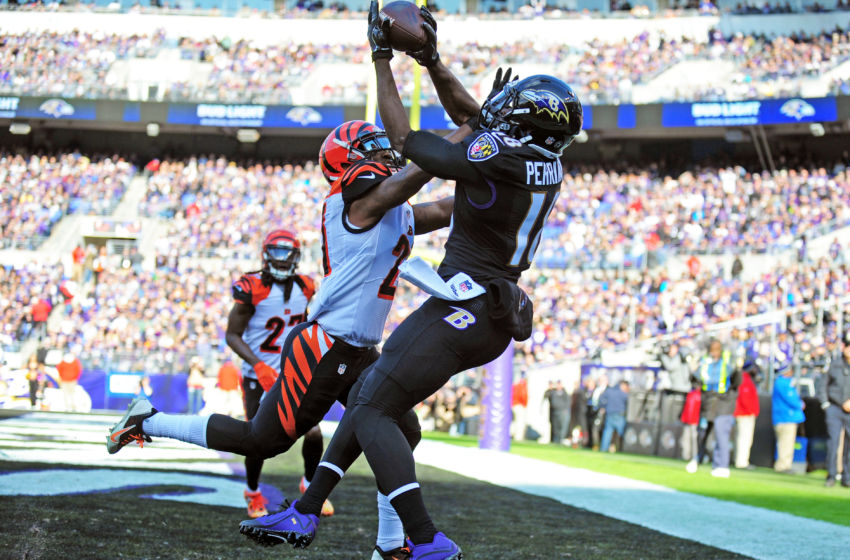 Nov 27, 2016; Baltimore, MD, USA; Baltimore Ravens wide receiver Breshad Perriman (18) catches a touchdown over Cincinnati Bengals cornerback Darqueze Dennard (21) in the first quarter at M&T Bank Stadium. Mandatory Credit: Evan Habeeb-USA TODAY Sports