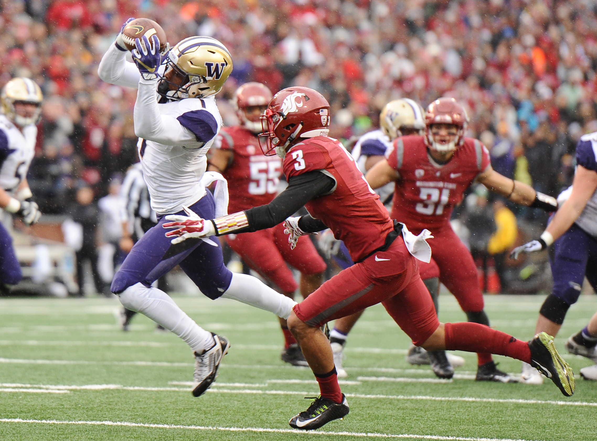 Nov 25, 2016; Pullman, WA, USA; Washington Huskies wide receiver John Ross (1) makes a catch in front of Washington State Cougars cornerback Darrien Molton (3) during the first half at Martin Stadium. Mandatory Credit: James Snook-USA TODAY Sports