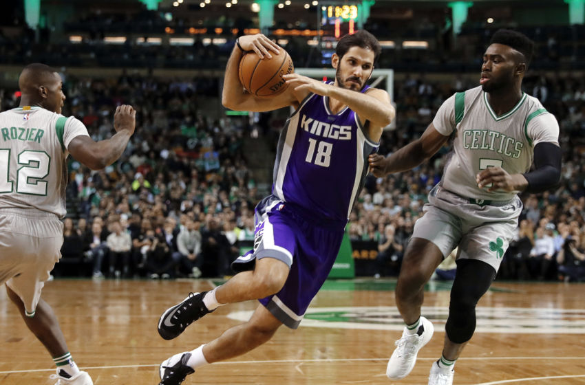 Dec 2, 2016; Boston, MA, USA; Sacramento Kings forward Omri Casspi (18) drives between Boston Celtics guard Terry Rozier (12) and forward Jaylen Brown (7) during the first half at TD Garden. Mandatory Credit: Winslow Townson-USA TODAY Sports