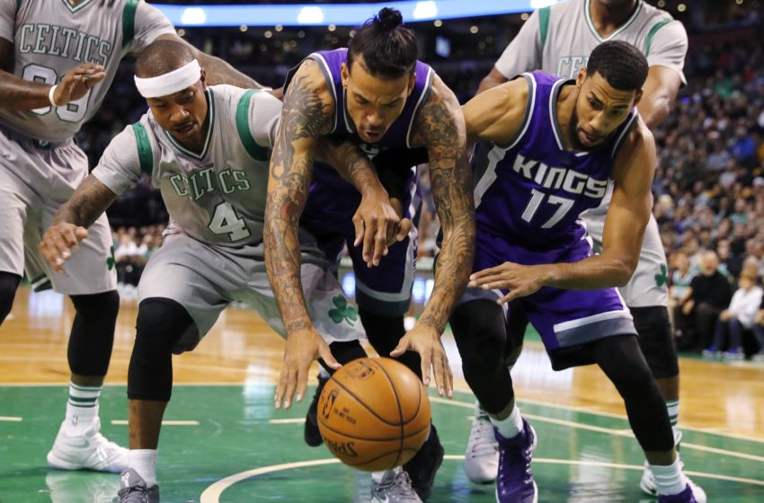 Dec 2, 2016; Boston, MA, USA; Boston Celtics guard Isaiah Thomas (4) and Sacramento Kings forward Matt Barnes (22) and Kings guard Garrett Temple (17) battle for a loose ball during the first half at TD Garden. Mandatory Credit: Winslow Townson-USA TODAY Sports