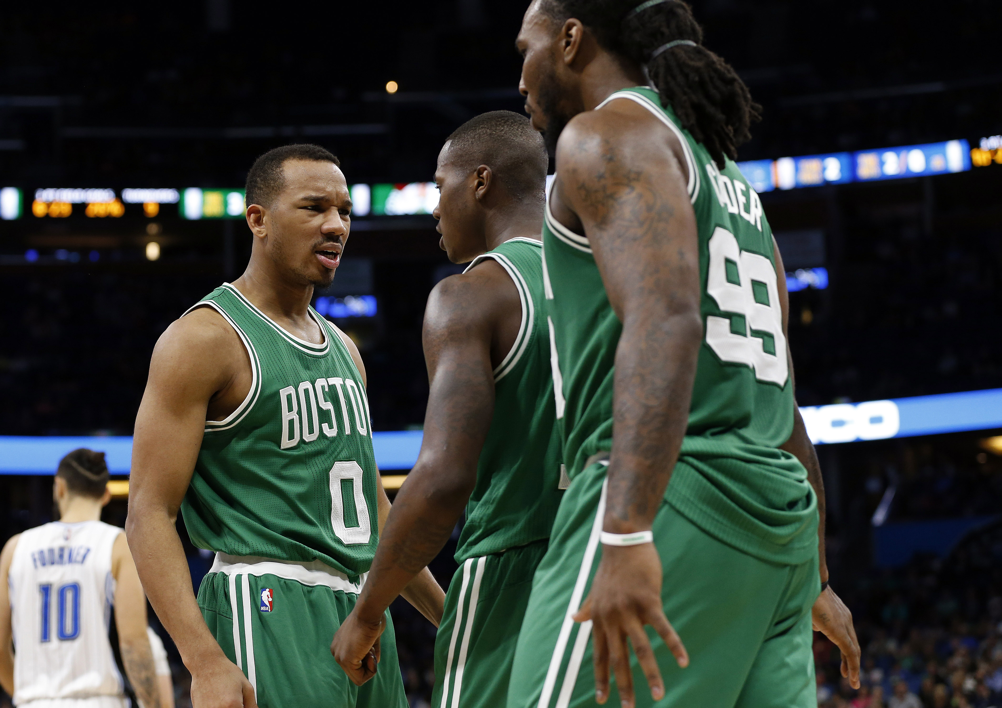 Dec 7, 2016; Orlando, FL, USA; Boston Celtics guard Avery Bradley (0) reacts with guard Terry Rozier (12) and forward Jae Crowder (99) against the Orlando Magic during the second half at Amway Center. Boston Celtics defeated the Orlando Magic 117-87. Mandatory Credit: Kim Klement-USA TODAY Sports