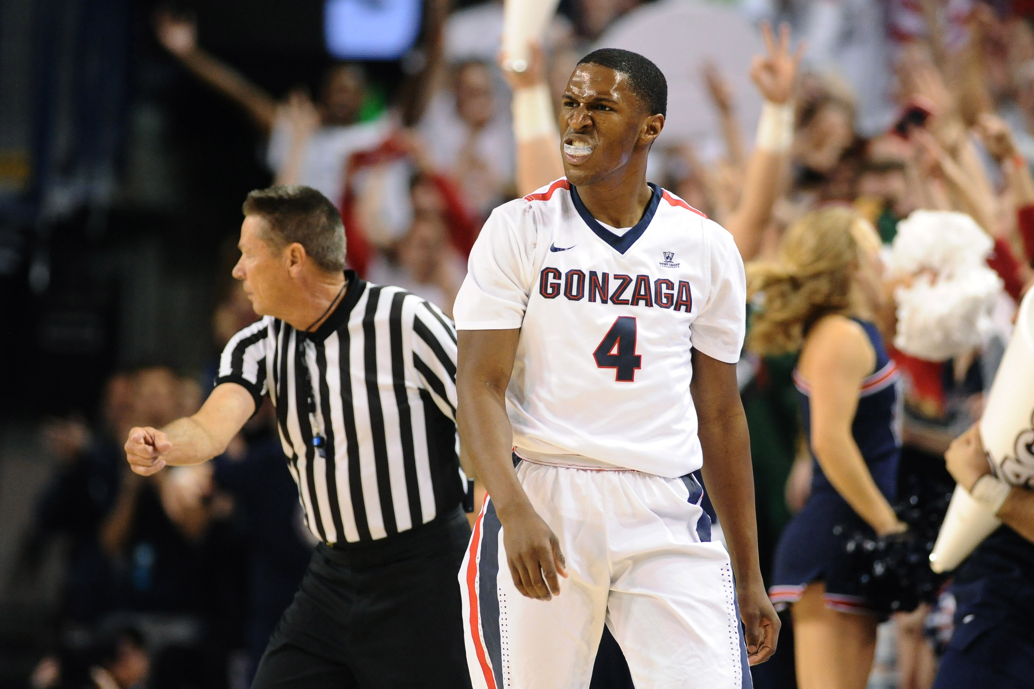 Dec 7, 2016; Spokane, WA, USA; Gonzaga Bulldogs guard Jordan Mathews (4) celebrates a three-pointer against the Washington Huskies during the first half at McCarthey Athletic Center. Mandatory Credit: James Snook-USA TODAY Sports