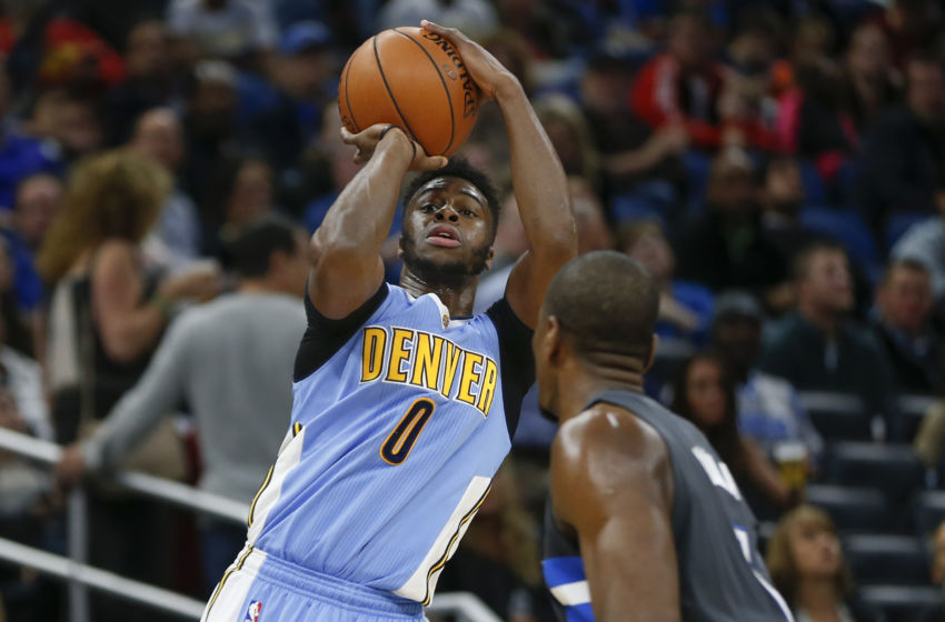 Dec 10, 2016; Orlando, FL, USA; Denver Nuggets guard Emmanuel Mudiay (0) shoots the ball over Orlando Magic forward Serge Ibaka (7) during the second quarter of an NBA basketball game at Amway Center. Mandatory Credit: Reinhold Matay-USA TODAY Sports