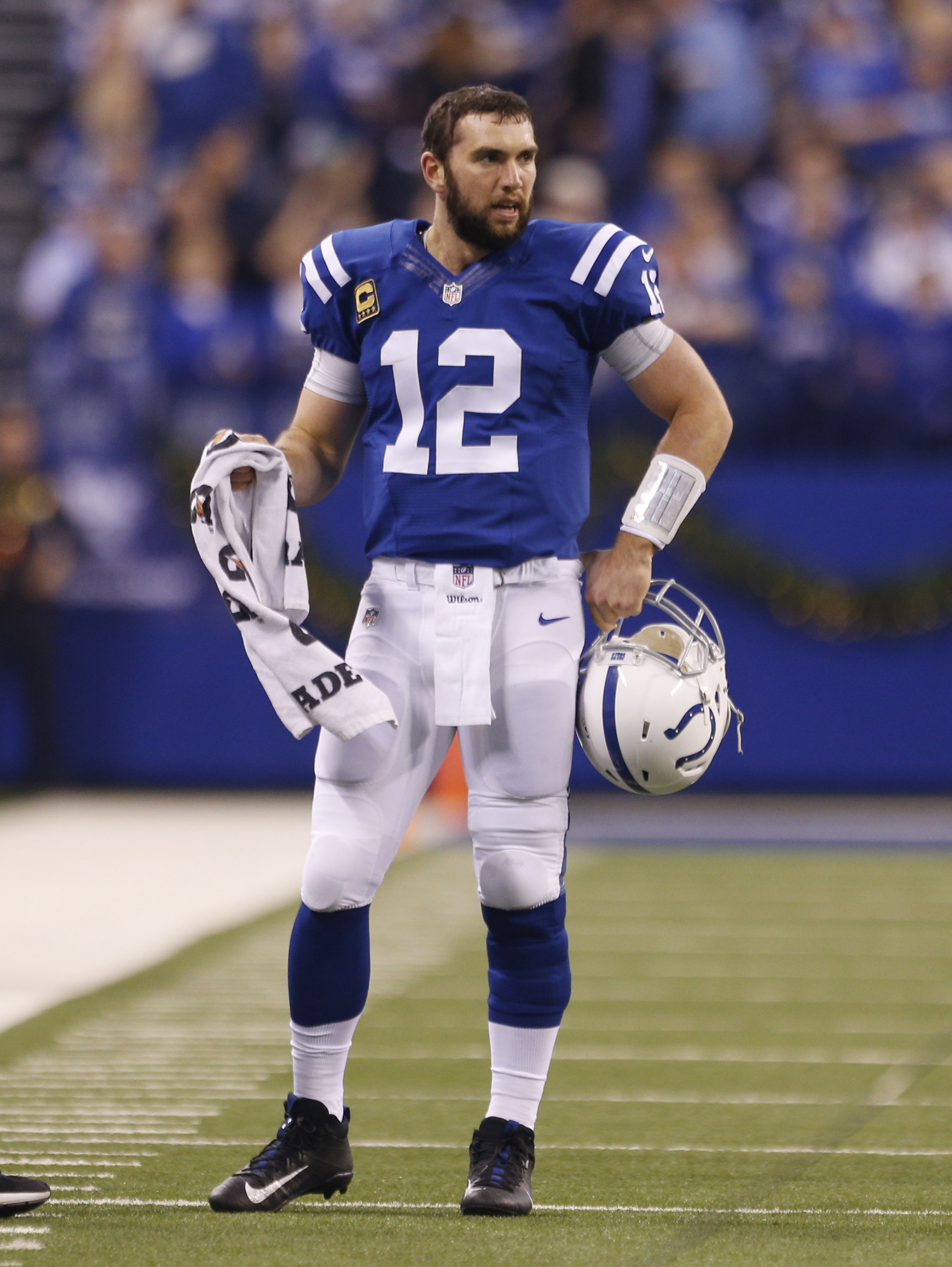 Dec 11, 2016; Indianapolis, IN, USA; Indianapolis Colts quarterback Andrew Luck (12) walks over to the sidelines as a play is reviewed by officials during a game against the Houston Texans at Lucas Oil Stadium. Mandatory Credit: Brian Spurlock-USA TODAY Sports