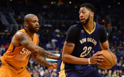 Dec 11, 2016; Phoenix, AZ, USA; New Orleans Pelicans forward Anthony Davis (23) handles the ball against Phoenix Suns forward P.J. Tucker (17) in the first half at Talking Stick Resort Arena. Mandatory Credit: Jennifer Stewart-USA TODAY Sports