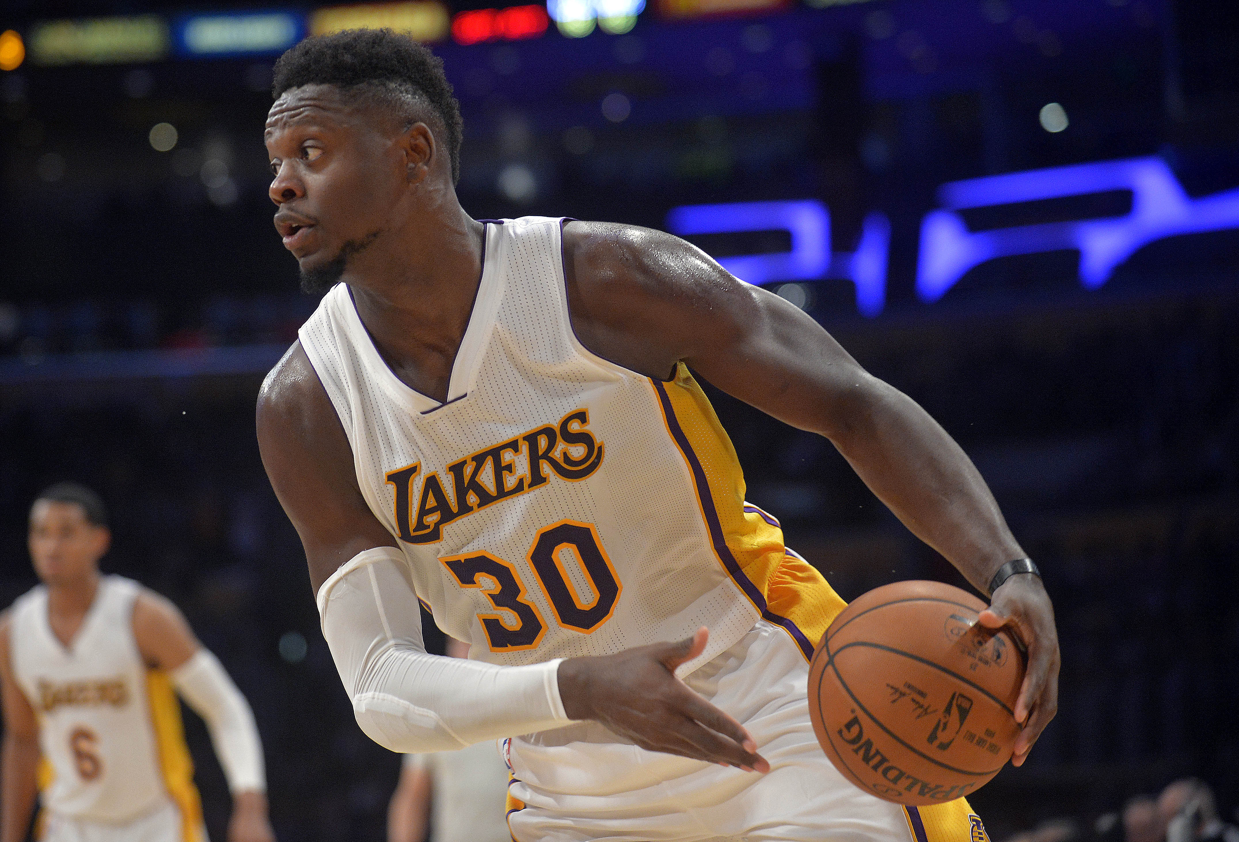 December 11, 2016; Los Angeles, CA, USA; Los Angeles Lakers forward Julius Randle (30) controls the ball against the New York Knicks during the second half at Staples Center. Mandatory Credit: Gary A. Vasquez-USA TODAY Sports