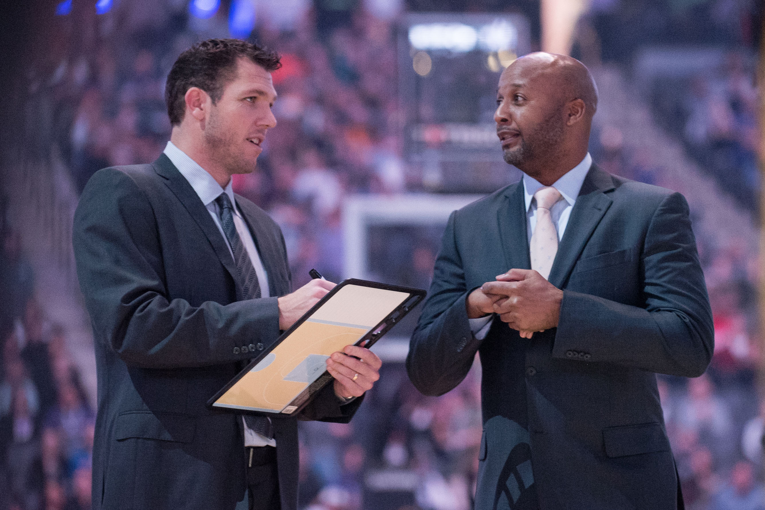 Dec 12, 2016; Sacramento, CA, USA; Los Angeles Lakers head coach Luke Walton and assistant head coach Brian Shaw chat before the game against the Sacramento Kings at Golden 1 Center. Mandatory Credit: Ed Szczepanski-USA TODAY Sports