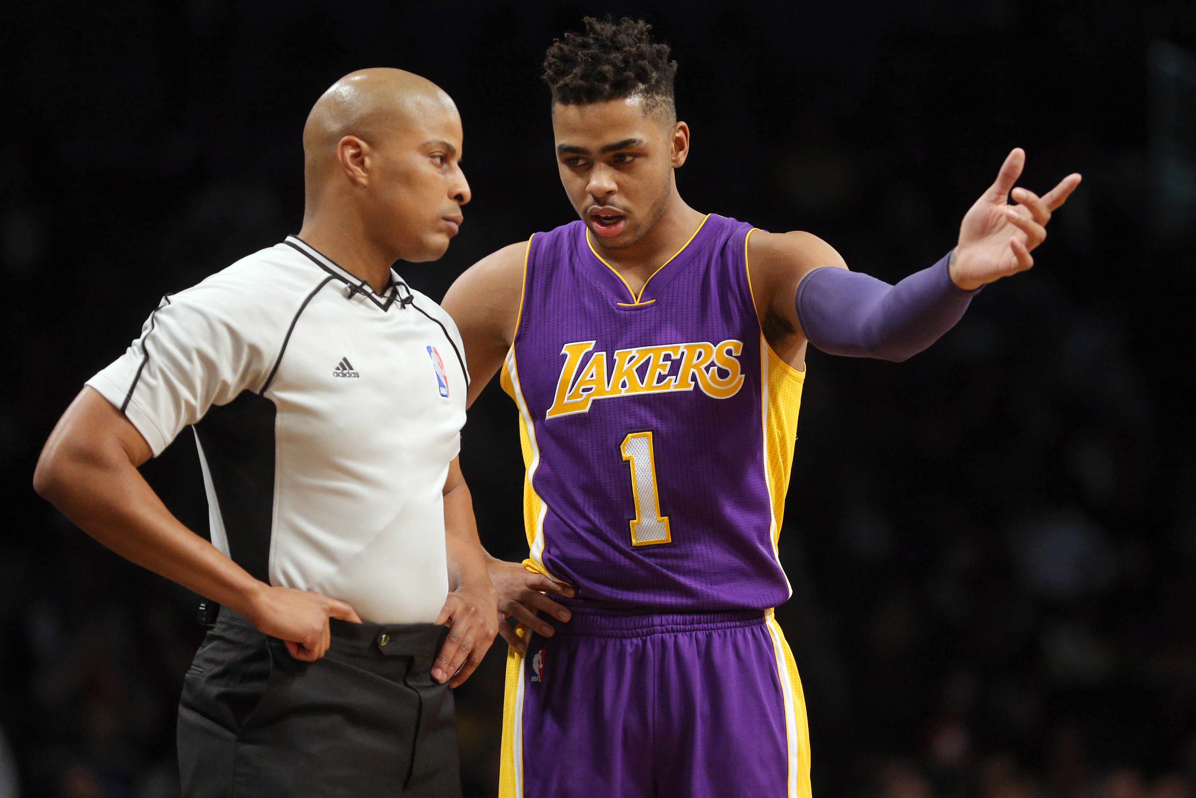Dec 14, 2016; Brooklyn, NY, USA; Los Angeles Lakers point guard D'Angelo Russell (1) argues a call with referee CJ Washington (53) during the fourth quarter against the Brooklyn Nets at Barclays Center. Mandatory Credit: Brad Penner-USA TODAY Sports