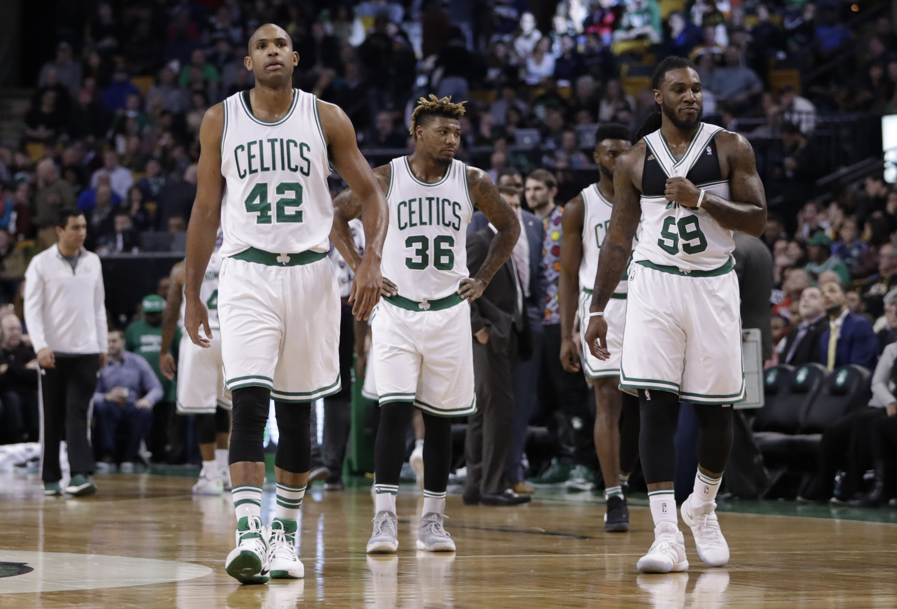 Dec 16, 2016; Boston, MA, USA; Boston Celtics center Al Horford (42), guard Marcus Smart (36) and forward Jae Crowder (99) on the court during a break in the action against the Charlotte Hornets in the second quarter at TD Garden. Mandatory Credit: David Butler II-USA TODAY Sports