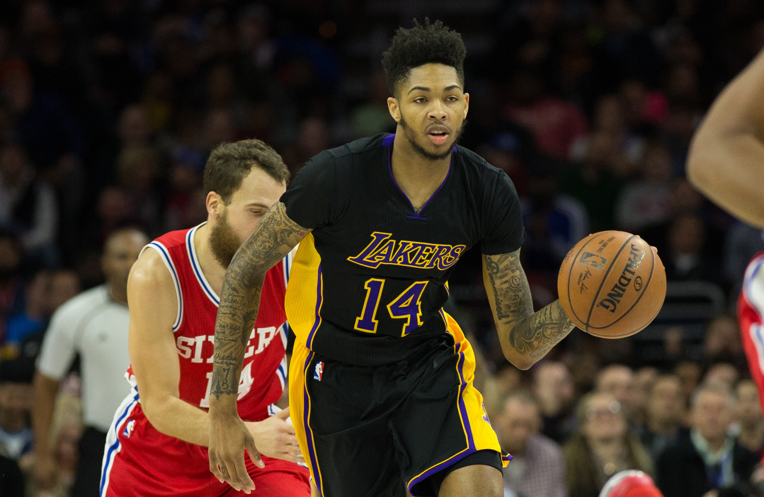Dec 16, 2016; Philadelphia, PA, USA; Los Angeles Lakers forward Brandon Ingram (14) dribbles past Philadelphia 76ers guard Sergio Rodriguez (14) during the second quarter at Wells Fargo Center. Mandatory Credit: Bill Streicher-USA TODAY Sports