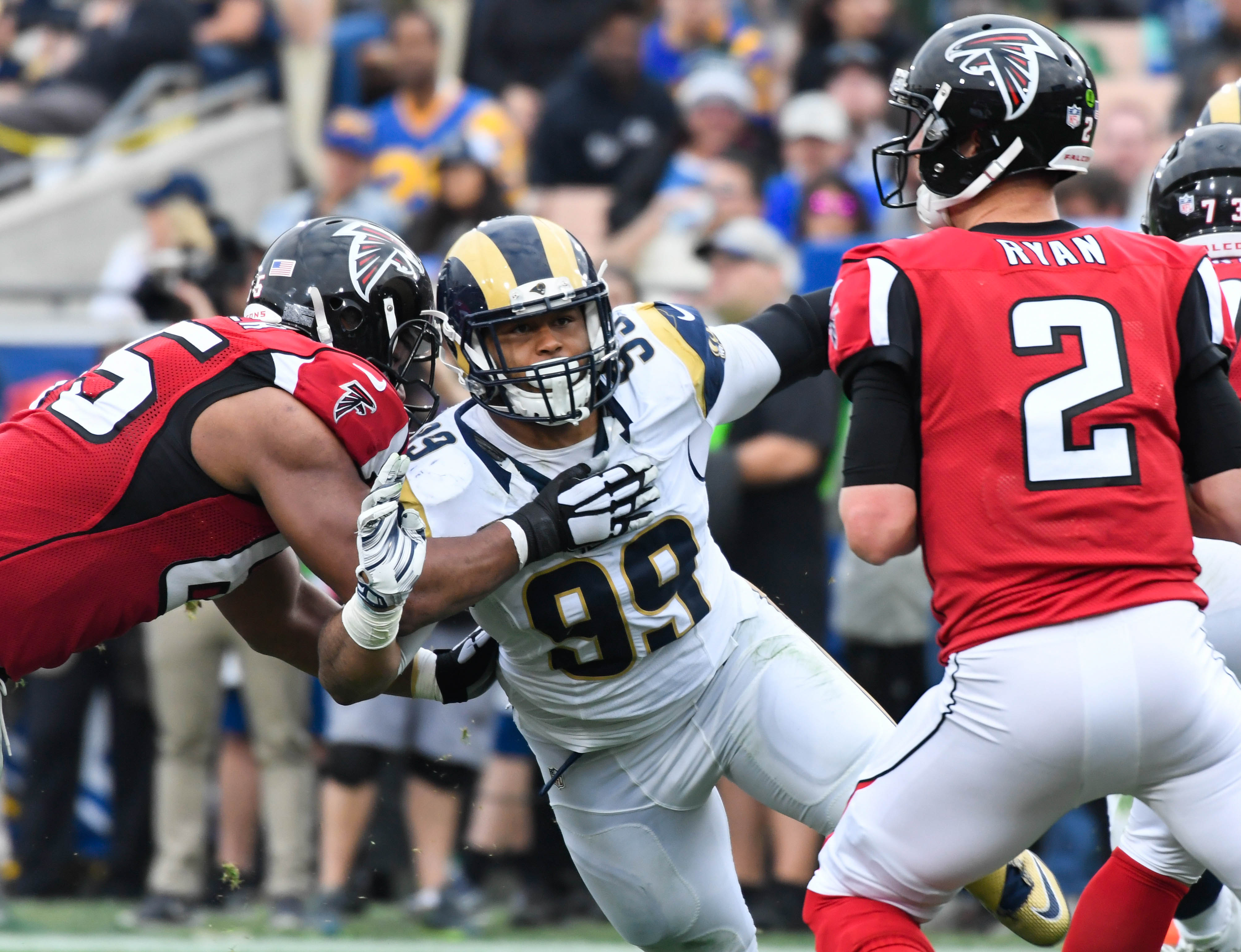 Dec 11, 2016; Los Angeles, CA, USA; Los Angeles Rams defensive tackle Aaron Donald (99) pressures Atlanta Falcons quarterback Matt Ryan (2) at the Los Angeles Memorial Coliseum. Mandatory Credit: Robert Hanashiro-USA TODAY Sports