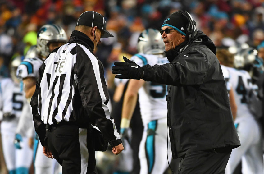 Dec 19, 2016; Landover, MD, USA; Carolina Panthers head coach Ron Rivera (R) discusses a call with back judge Greg Meyer (78) during the second half at FedEx Field. Mandatory Credit: Brad Mills-USA TODAY Sports