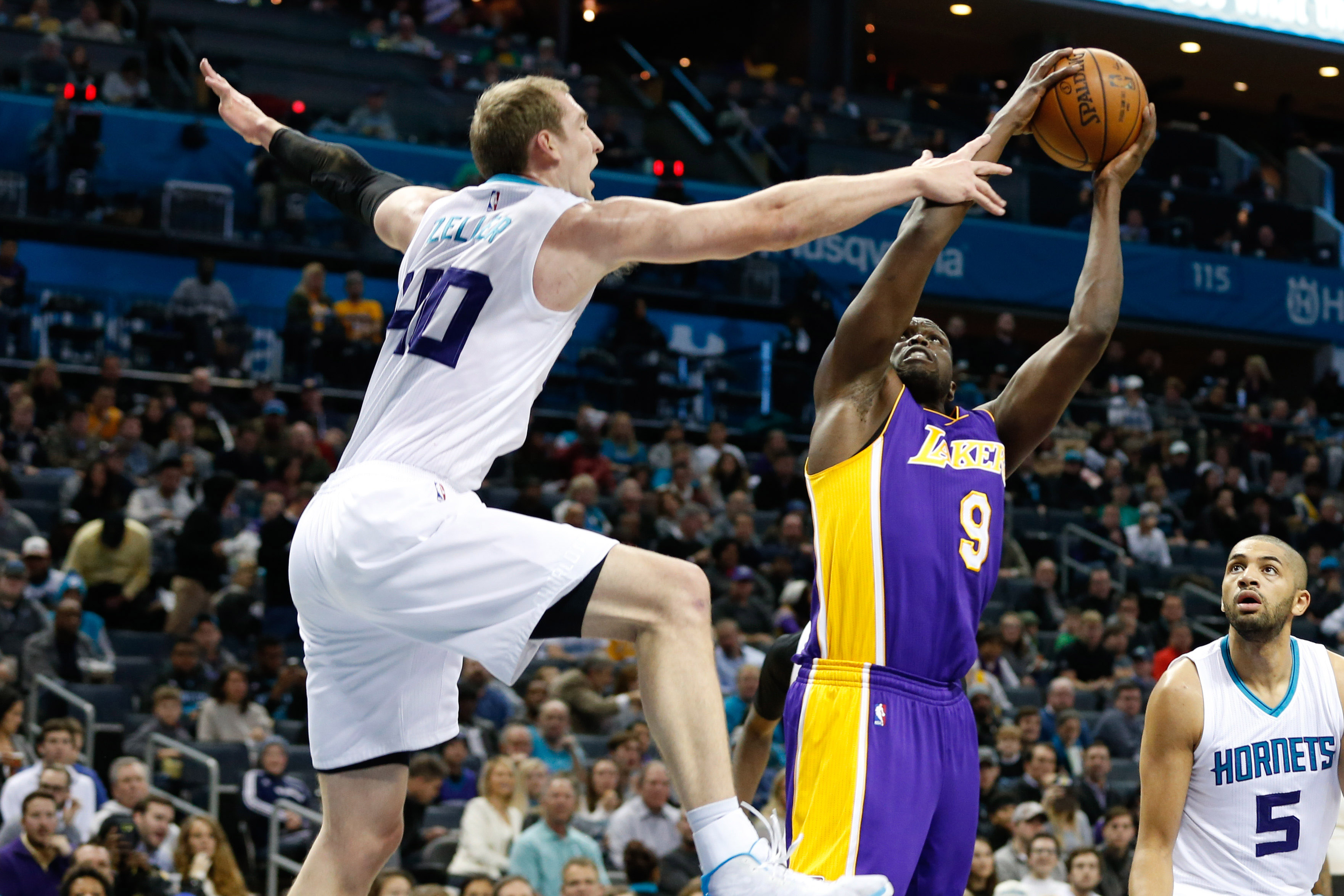 Dec 20, 2016; Charlotte, NC, USA; Los Angeles Lakers forward Luol Deng (9) goes up for a shot against Charlotte Hornets center Cody Zeller (40) in the first half at Spectrum Center. Mandatory Credit: Jeremy Brevard-USA TODAY Sports