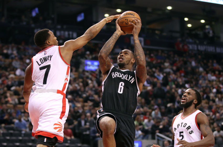 Dec 20, 2016; Toronto, Ontario, CAN; Brooklyn Nets guard Sean Kilpatrick (6) is fouled by Toronto Raptors point guard Kyle Lowry (7) at Air Canada Centre. The Raptors beat the Nets 116-104. Mandatory Credit: Tom Szczerbowski-USA TODAY Sports