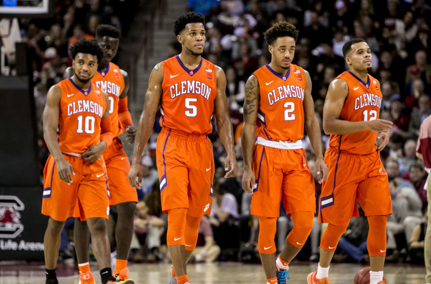 Dec 21, 2016; Columbia, SC, USA; Clemson Tigers guard Gabe DeVoe (10) and Clemson Tigers center Sidy Djitte (50) and Clemson Tigers forward Jaron Blossomgame (5) and Clemson Tigers guard Marcquise Reed (2) and Clemson Tigers guard Avry Holmes (12) against the South Carolina Gamecocks in the second half at Colonial Life Arena. Clemson won 62-60. Mandatory Credit: Jeff Blake-USA TODAY Sports