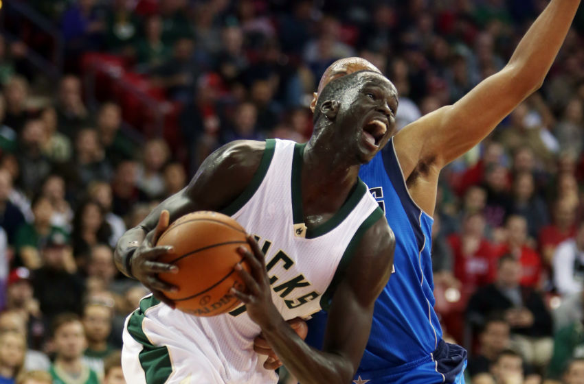 Oct 8, 2016; Madison, WI, USA; Milwaukee Bucks forward Thon Maker (7) gets past a Dallas Mavericks defender at the Kohl Center. Milwaukee defeated Dallas 88-74. Mandatory Credit: Mary Langenfeld-USA TODAY Sports