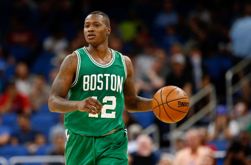 Dec 7, 2016; Orlando, FL, USA; Boston Celtics guard Terry Rozier (12) dribbles the ball against the Orlando Magic during the second half at Amway Center. Boston Celtics defeated the Orlando Magic 117-87. Mandatory Credit: Kim Klement-USA TODAY Sports