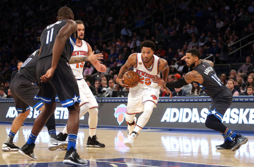 Dec 22, 2016; New York, NY, USA; New York Knicks point guard Derrick Rose (25) drives against Orlando Magic point guard D.J. Augustin (14) during the third quarter at Madison Square Garden. Mandatory Credit: Brad Penner-USA TODAY Sports