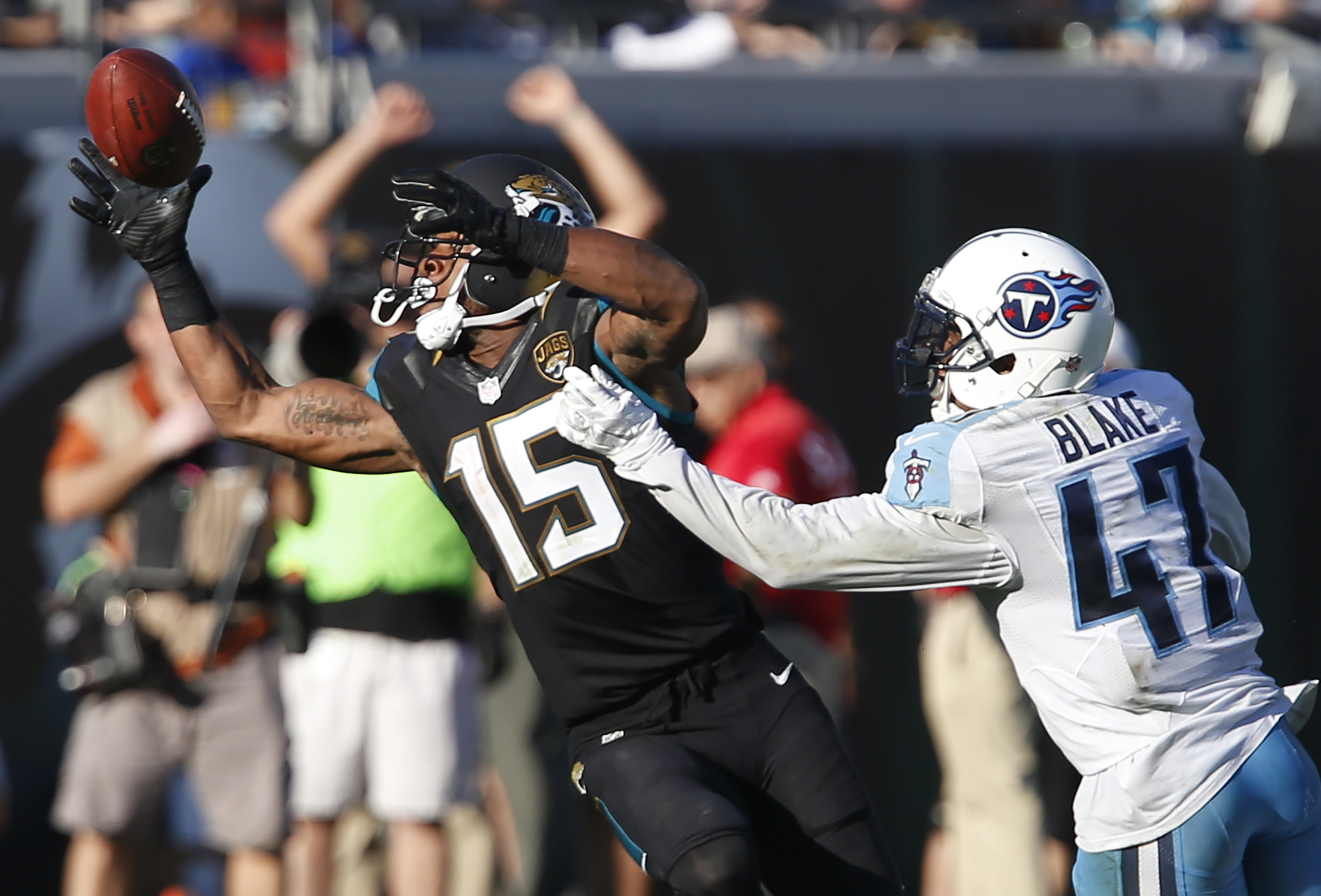 Dec 24, 2016; Jacksonville, FL, USA; Jacksonville Jaguars wide receiver Allen Robinson (15) makes a one handed catch as Tennessee Titans defensive back Valentino Blake (47) defends during the second half of an NFL football game at EverBank Field.The Jaguars won 38-17. Mandatory Credit: Reinhold Matay-USA TODAY Sports