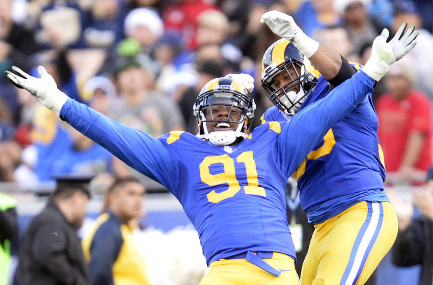 December 24, 2016; Los Angeles, CA, USA; Los Angeles Rams defensive tackle Dominique Easley (91) celebrates with defensive tackle Aaron Donald (99) after sacking San Francisco 49ers quarterback Colin Kaepernick (7) during the first half at Los Angeles Memorial Coliseum. Mandatory Credit: Gary A. Vasquez-USA TODAY Sports