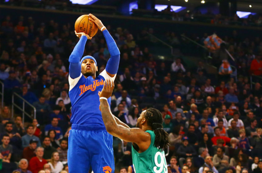 Dec 25, 2016; New York, NY, USA; New York Knicks forward Carmelo Anthony (7) takes a shot while being defended by Boston Celtics forward Jae Crowder (99) during the first half at Madison Square Garden. Mandatory Credit: Andy Marlin-USA TODAY Sports