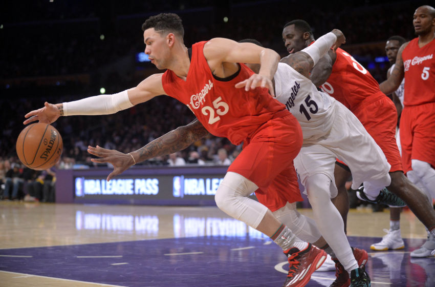December 25, 2016; Los Angeles, CA, USA; Los Angeles Clippers guard Austin Rivers (25) reaches for the ball ahead of Los Angeles Lakers forward Thomas Robinson (15) during the second half at Staples Center. Mandatory Credit: Gary A. Vasquez-USA TODAY Sports