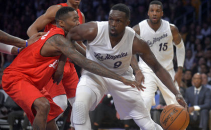 December 25, 2016; Los Angeles, CA, USA;  Los Angeles Lakers forward Luol Deng (9) moves the ball against the defense of Los Angeles Clippers  guard Jamal Crawford (11) during the second half at Staples Center. Mandatory Credit: Gary A. Vasquez-USA TODAY Sports