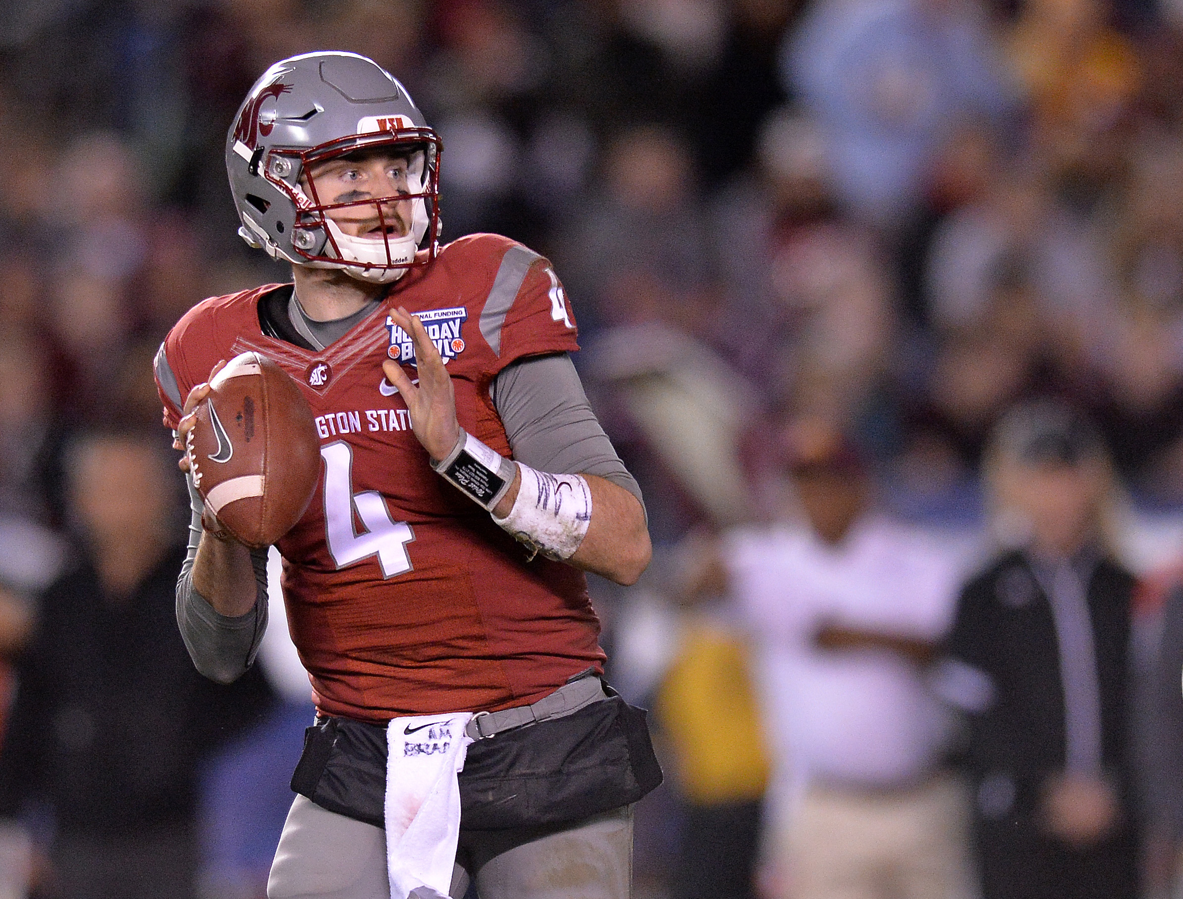 Dec 27, 2016; San Diego , CA, USA; Washington State Cougars quarterback Luke Falk (4) looks to pass against the Minnesota Golden Gophers during the second quarter at Qualcomm Stadium. Mandatory Credit: Jake Roth-USA TODAY Sports
