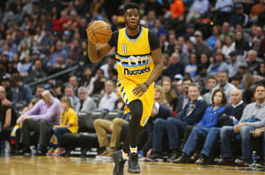 Dec 28, 2016; Denver, CO, USA; Denver Nuggets guard Emmanuel Mudiay (0) brings the ball up the court during the first half against the Minnesota Timberwolves at Pepsi Center. Mandatory Credit: Chris Humphreys-USA TODAY Sports