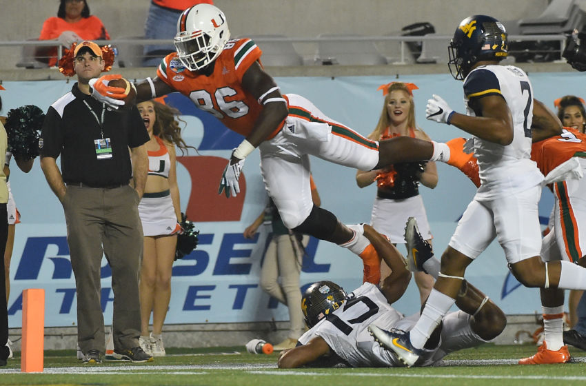 Dec 28, 2016; Orlando, FL, USA; Miami Hurricanes tight end David Njoku (86) dives for the end zone to score a touchdown against the West Virginia Mountaineers during the second half at Camping World Stadium. The Miami Hurricanes defeat the West Virginia Mountaineers 31-14. Mandatory Credit: Jasen Vinlove-USA TODAY Sports