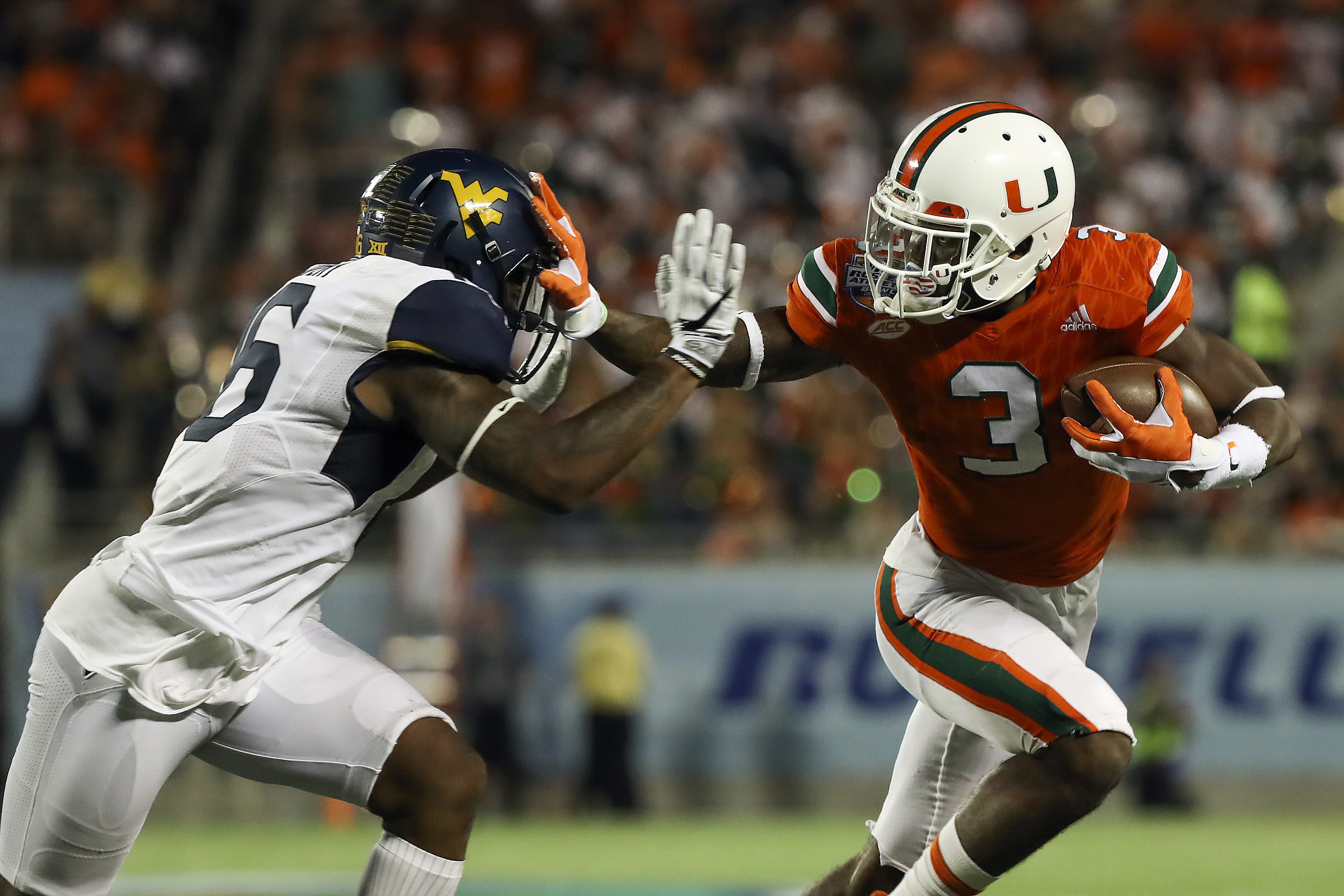 9772983-ncaa-football-russell-athletic-bowl-west-virginia-vs-miami