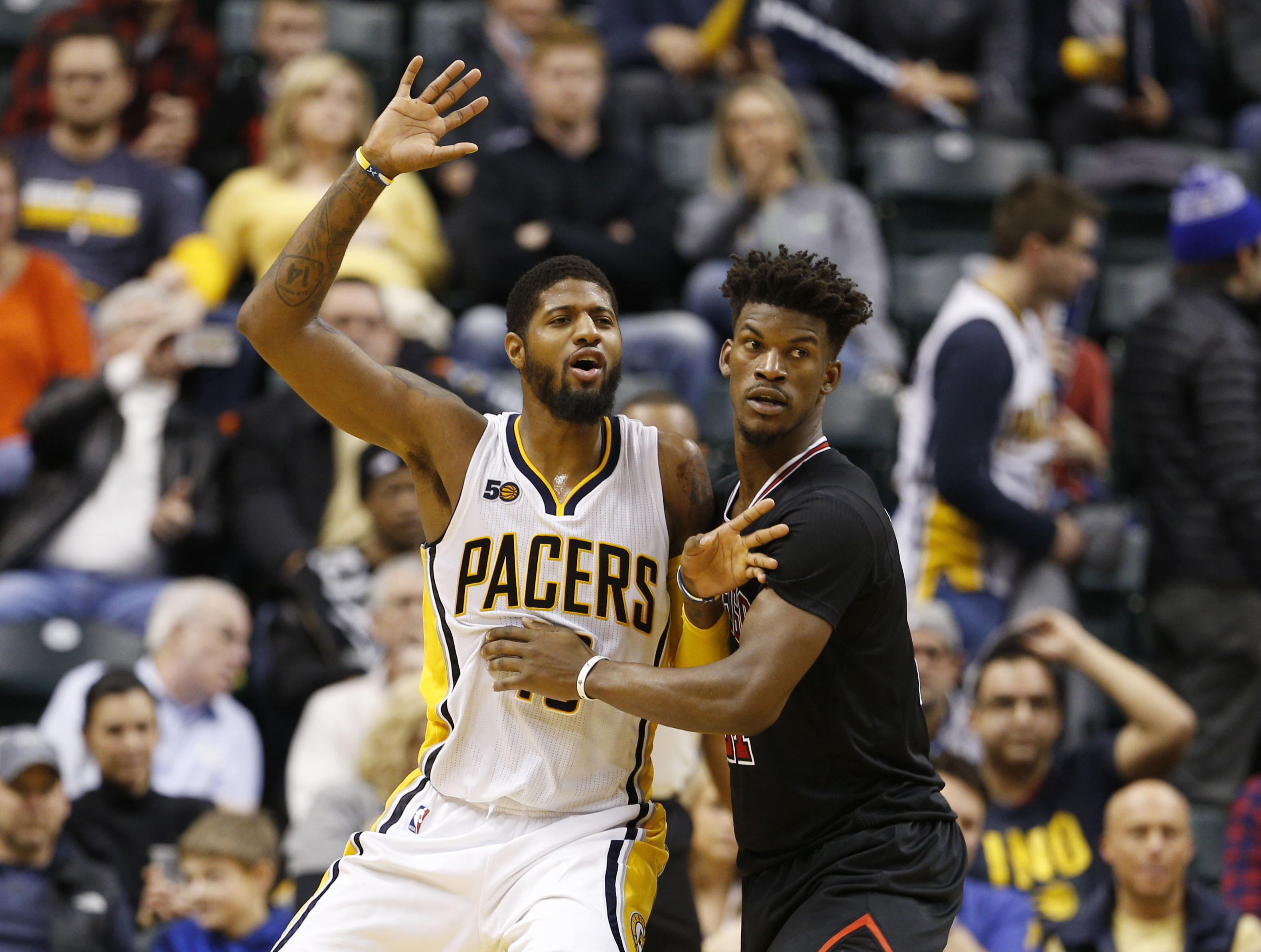 Dec 30, 2016; Indianapolis, IN, USA; Indiana Pacers forward Paul George (13) is guarded by Chicago Bulls guard Jimmy Butler (21) at Bankers Life Fieldhouse. Indiana defeated Chicago 111-101. Mandatory Credit: Brian Spurlock-USA TODAY Sports