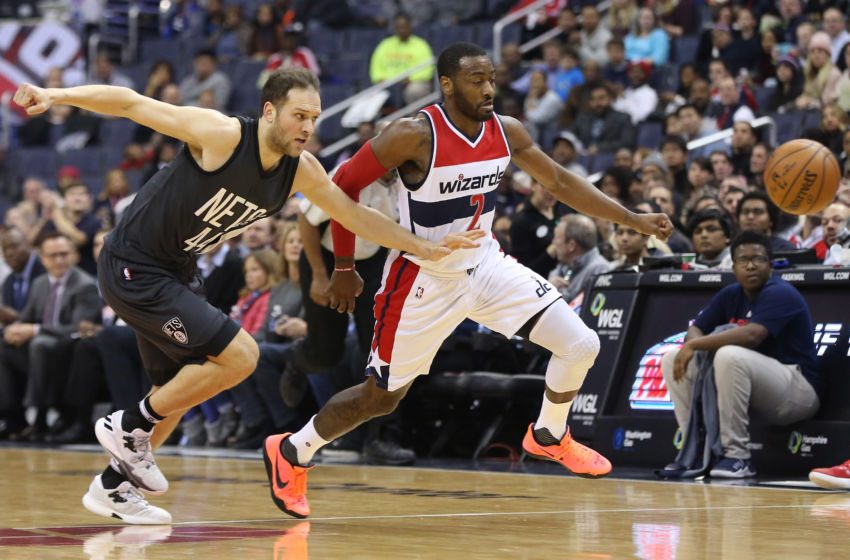 Dec 30, 2016; Washington, DC, USA; Washington Wizards guard John Wall (2) and Brooklyn Nets guard Bojan Bogdanovic (44) chase a loose ball in the first quarter at Verizon Center. Mandatory Credit: Geoff Burke-USA TODAY Sports