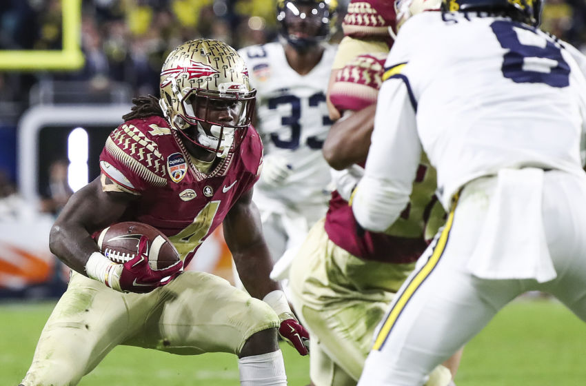Dec 30, 2016; Miami Gardens, FL, USA; Florida State Seminoles running back Dalvin Cook (4) runs the ball in the second half against the Michigan Wolverines at Hard Rock Stadium. The Seminoles won 33-32. Mandatory Credit: Logan Bowles-USA TODAY Sports