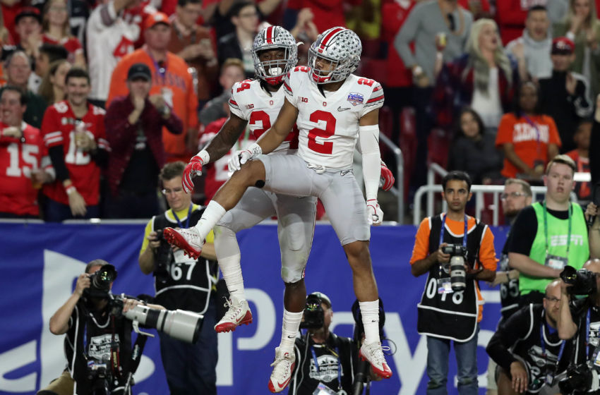 December 31, 2016; Glendale, AZ, USA; Ohio State Buckeyes safety Malik Hooker (24) celebrates with cornerback Marshon Lattimore (2) after intercepting pass against the Clemson Tigers during the first half of the the 2016 CFP semifinal at University of Phoenix Stadium. Mandatory Credit: Matthew Emmons-USA TODAY Sports