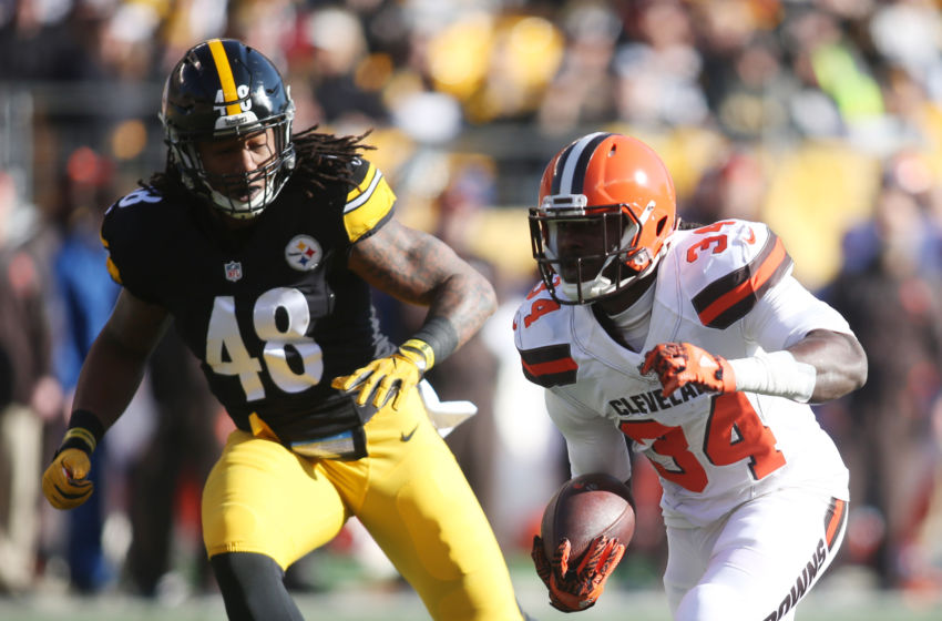 Jan 1, 2017; Pittsburgh, PA, USA;  Cleveland Browns running back Isaiah Crowell (34) rushes the ball against Pittsburgh Steelers outside linebacker Bud Dupree (48) during the first quarter at Heinz Field. Mandatory Credit: Charles LeClaire-USA TODAY Sports