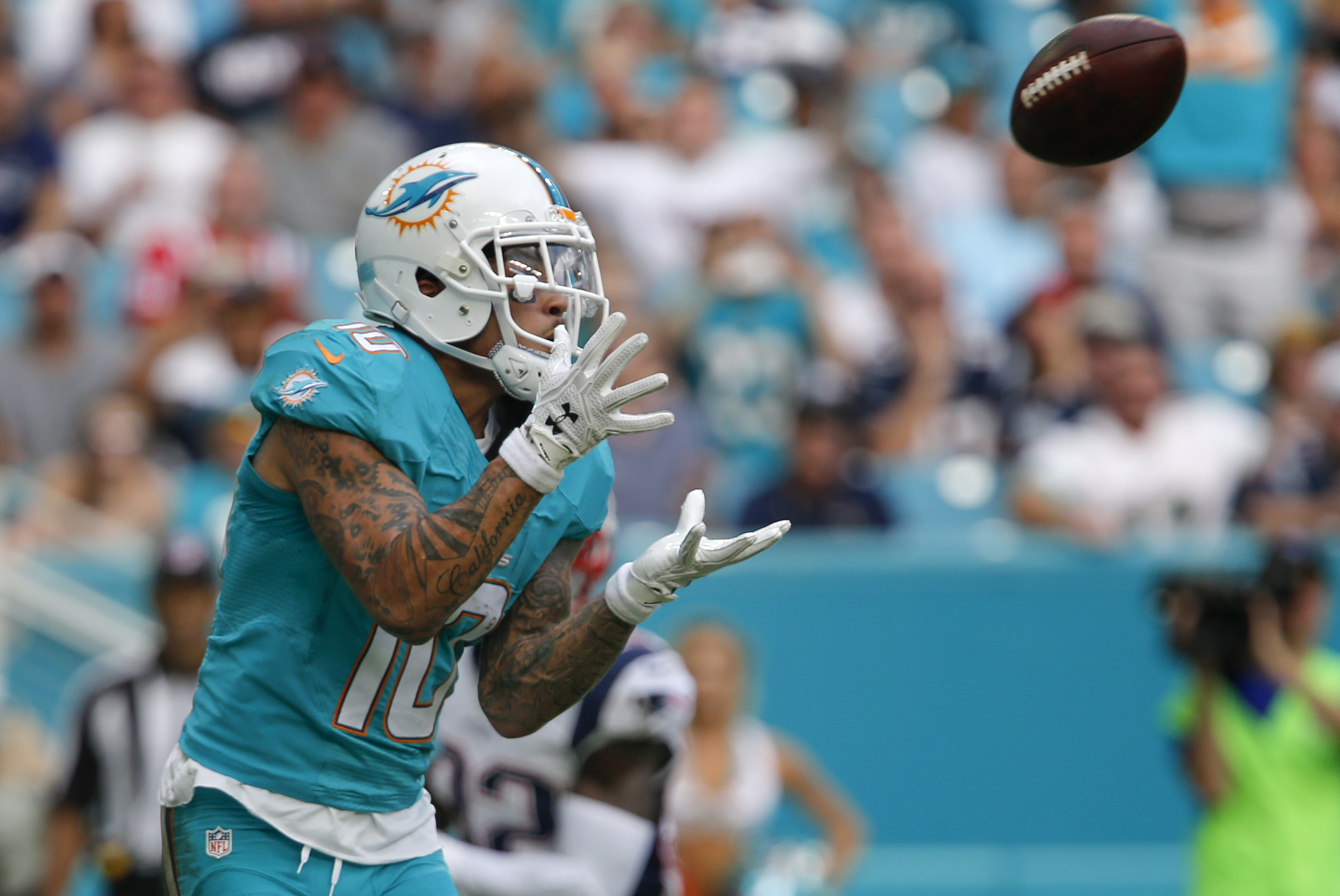 Jan 1, 2017; Miami Gardens, FL, USA; Miami Dolphins wide receiver Kenny Stills (10) catches a touchdown pass during the second half of an NFL football game against the New England Patriots at Hard Rock Stadium. The Patriots won 35-14. Mandatory Credit: Reinhold Matay-USA TODAY Sports