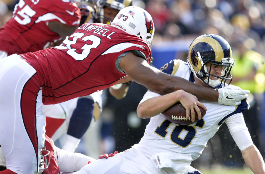 January 1, 2017; Los Angeles, CA, USA; Los Angeles Rams quarterback Jared Goff (16) is brought down by Arizona Cardinals defensive end Calais Campbell (93) during the first half at Los Angeles Memorial Coliseum. Mandatory Credit: Gary A. Vasquez-USA TODAY Sports
