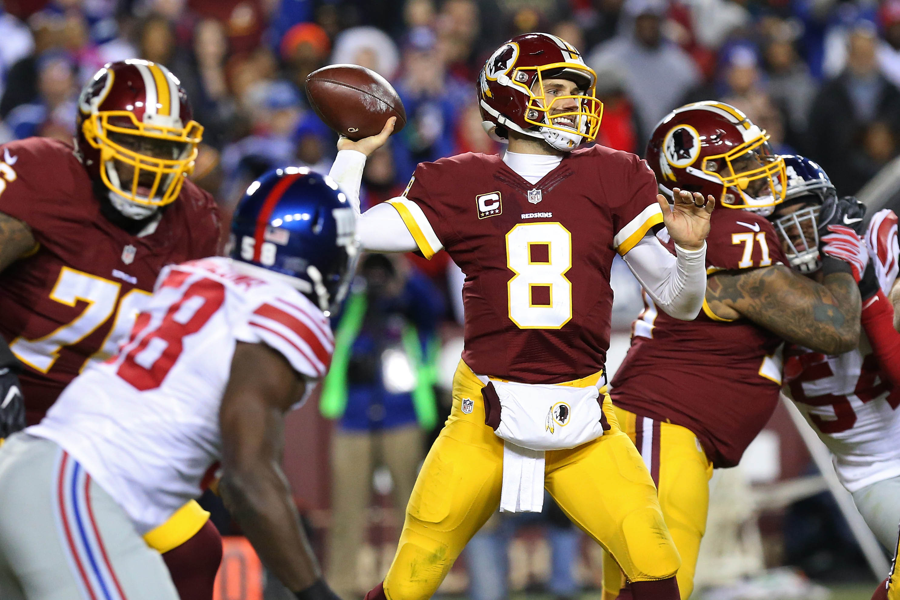 Jan 1, 2017; Landover, MD, USA; Washington Redskins quarterback Kirk Cousins (8) throws the ball as New York Giants defensive end Owa Odighizuwa (58) chases in the third quarter at FedEx Field. The Giants won 19-10. Mandatory Credit: Geoff Burke-USA TODAY Sports