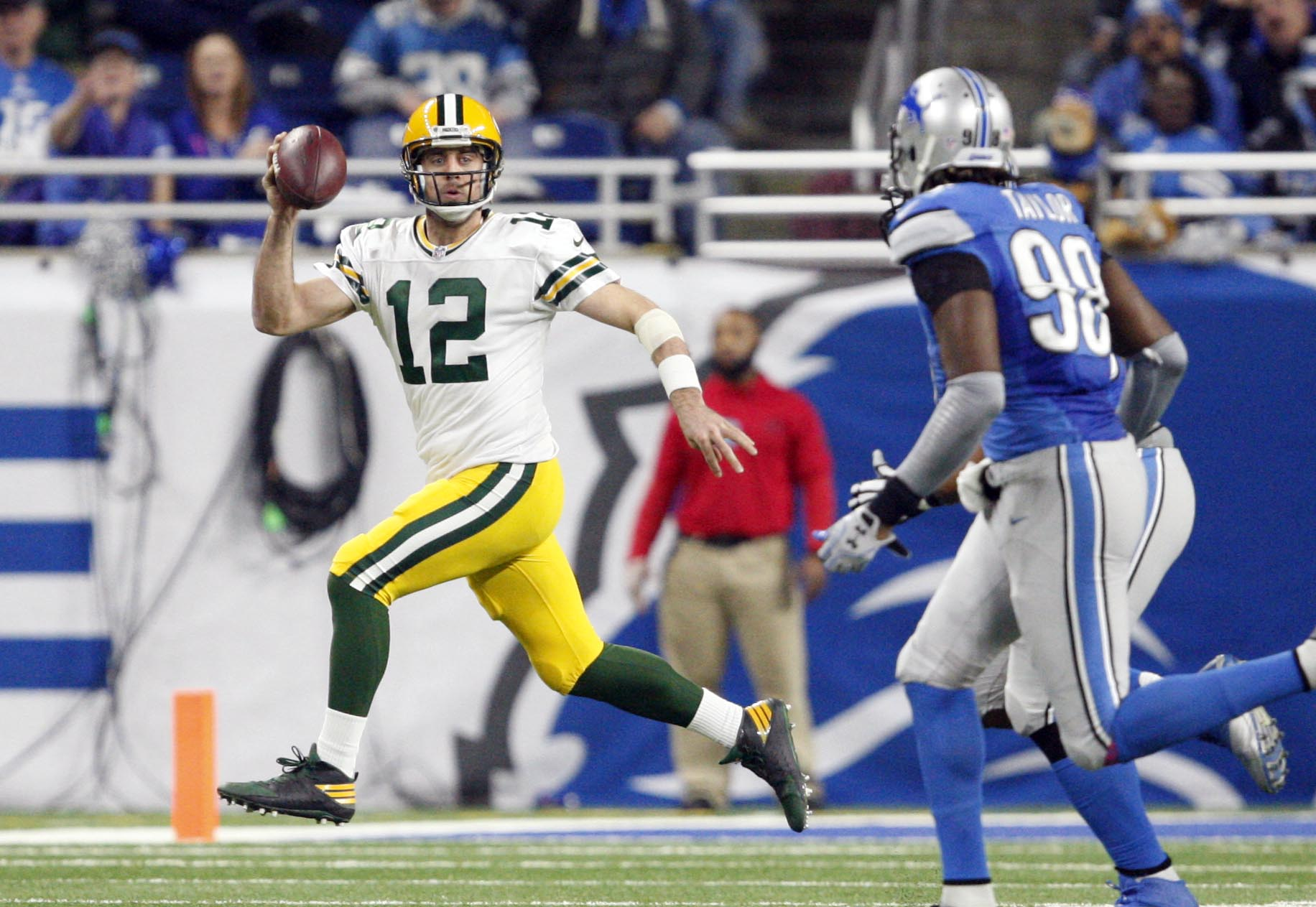 Jan 1, 2017; Detroit, MI, USA; Green Bay Packers quarterback Aaron Rodgers (12) gets chased by Detroit Lions defensive end Devin Taylor (98) during the second quarter at Ford Field. Packers won 31-24. Mandatory Credit: Raj Mehta-USA TODAY Sports