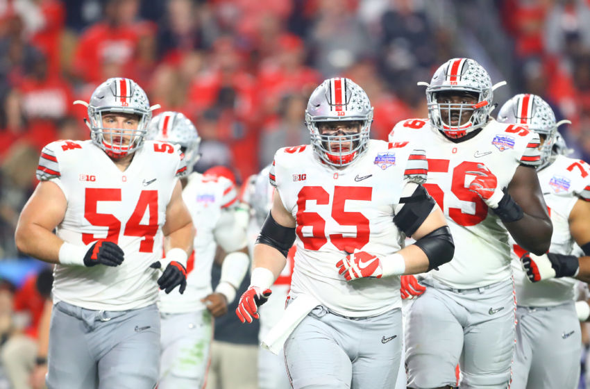December 31, 2016; Glendale, AZ, USA; Ohio State Buckeyes offensive lineman Billy Price (54), Pat Elflein (65) and Isaiah Prince (59) against the Clemson Tigers in the 2016 CFP semifinal at University of Phoenix Stadium. Mandatory Credit: Mark J. Rebilas-USA TODAY Sports