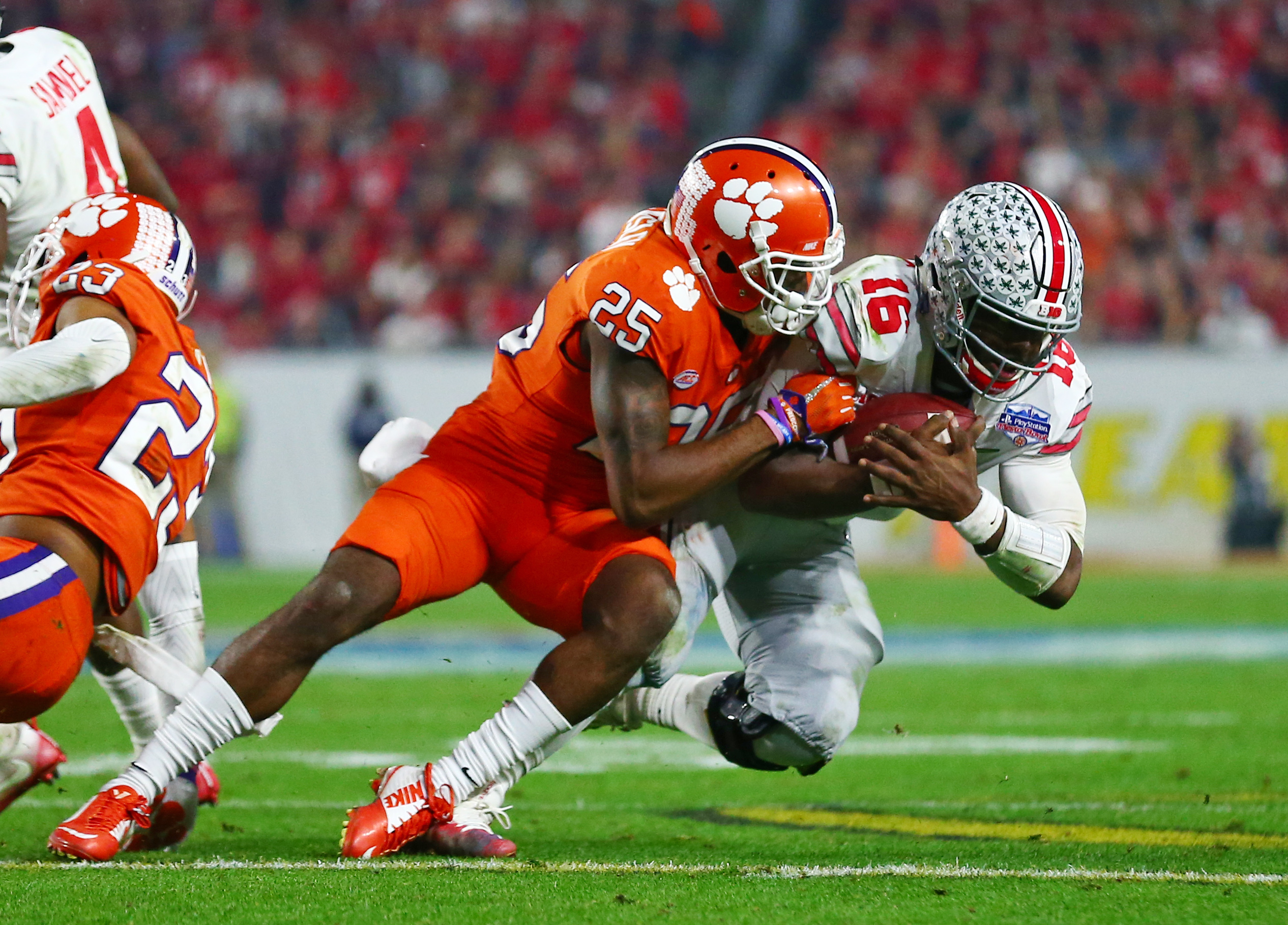 December 31, 2016; Glendale, AZ, USA; Clemson Tigers cornerback Cordrea Tankersley (25) sacks Ohio State Buckeyes quarterback J.T. Barrett (16) in the the 2016 CFP semifinal at University of Phoenix Stadium. Mandatory Credit: Mark J. Rebilas-USA TODAY Sports