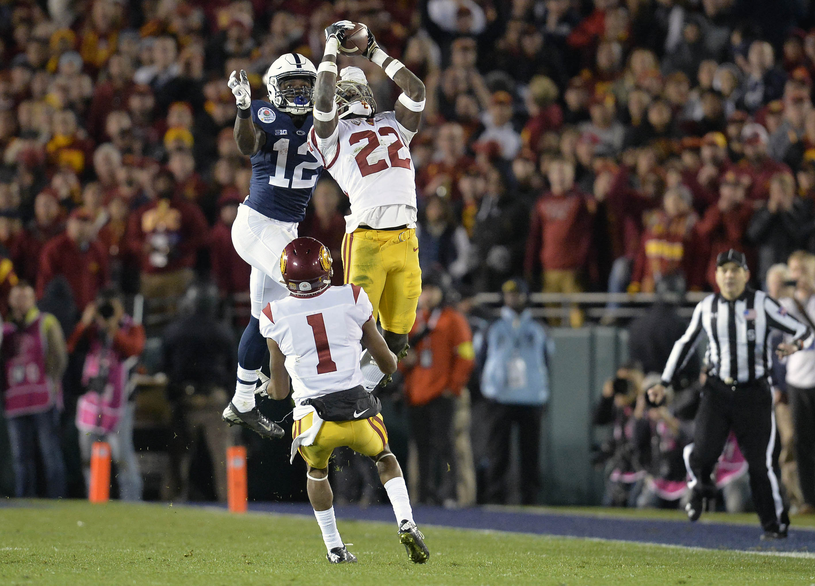 January 2, 2017; Pasadena, CA, USA; Southern California Trojans defensive back Leon McQuay III (22) intercepts a pass intended for Penn State Nittany Lions wide receiver Chris Godwin (12) during the second half of the 2017 Rose Bowl game at the Rose Bowl. Mandatory Credit: Gary A. Vasquez-USA TODAY Sports